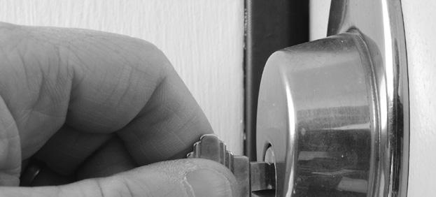 hand-putting-key-in-lock-blk-white