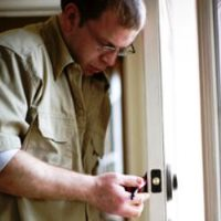 pro locksmith changing door lock
